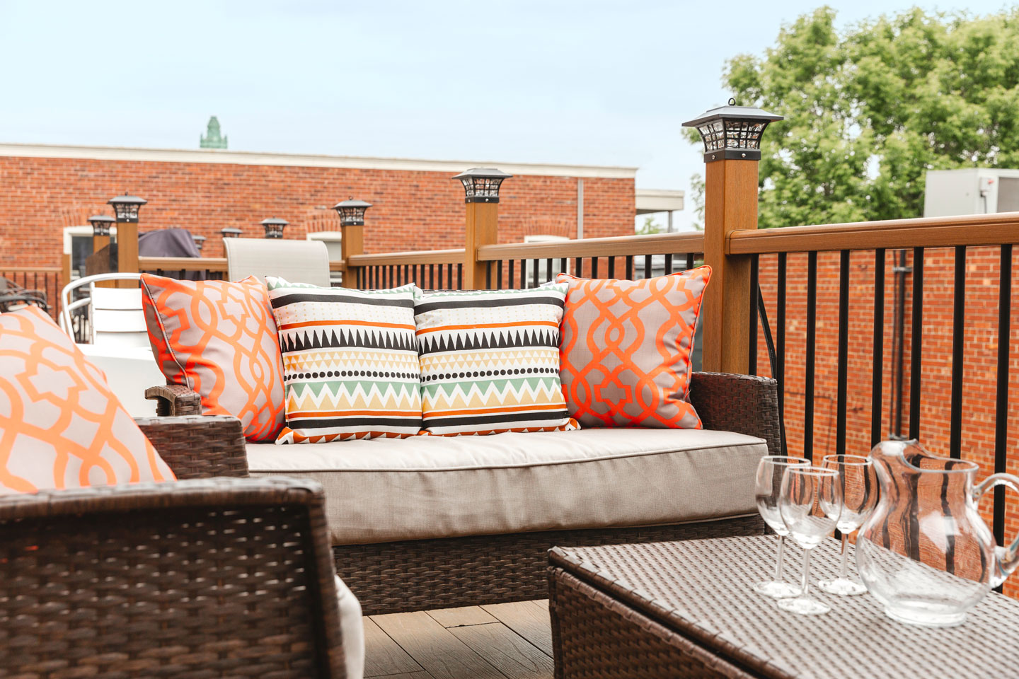 Golden kiss: sunny patio, outdoor lounge furniture and BBQ