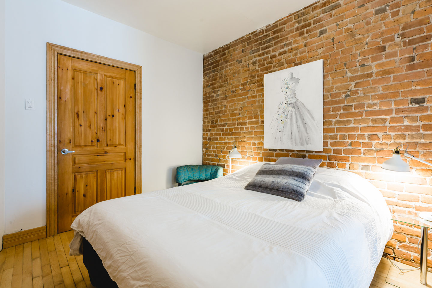 City chalet: bedroom with brick wall and queen bed with comfortable memory foam mattress