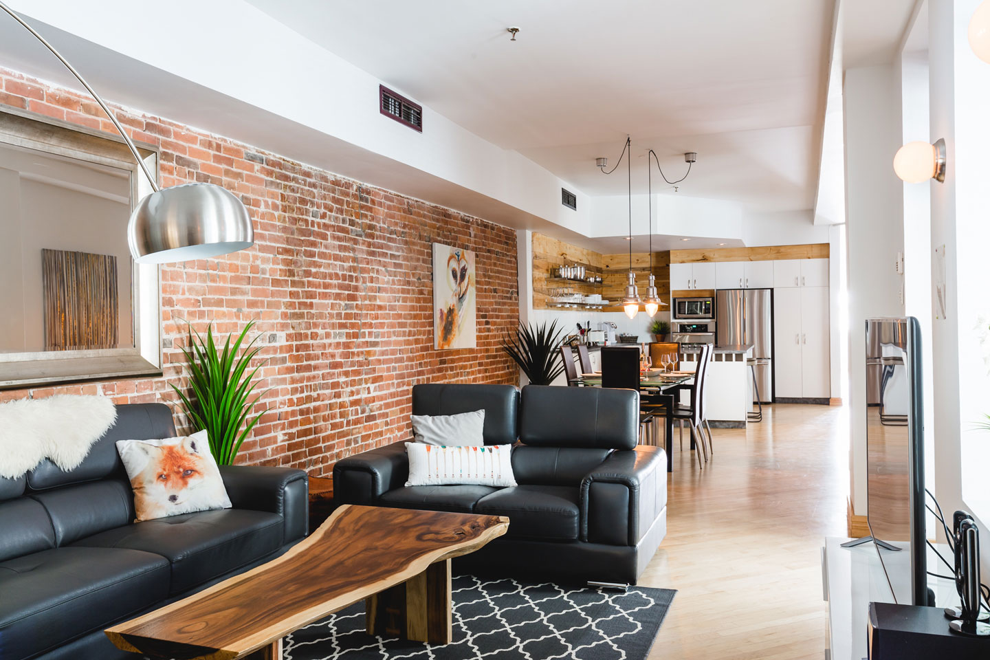 City chalet: roomy open layout living room