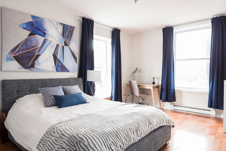 Suite 101: master bedroom with queen bed and memory foam mattress